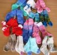 Nuteistųjų numegztos kojinytės šildys naujagimius