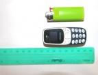 Suimtajam nepavyko nuslėpti itin mažo ir sunkiai aptinkamo mobiliojo ryšio telefono